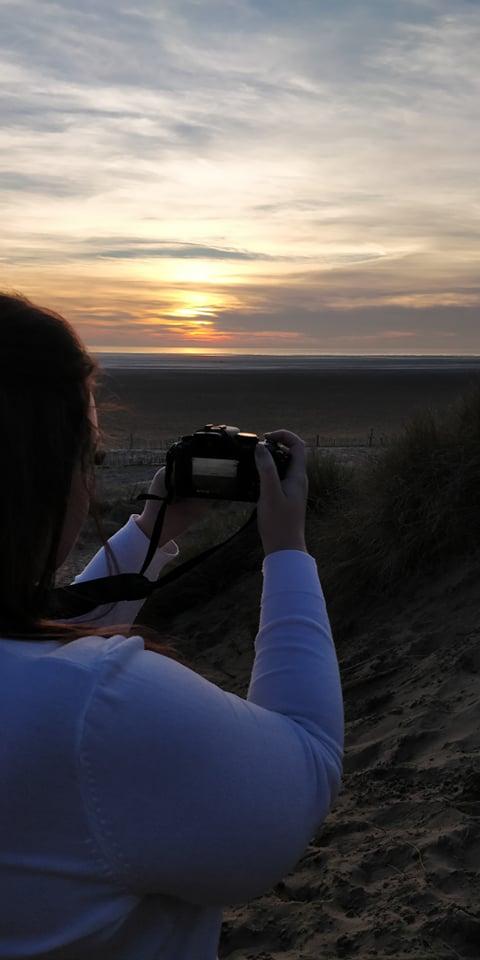 camera woman sunset beach