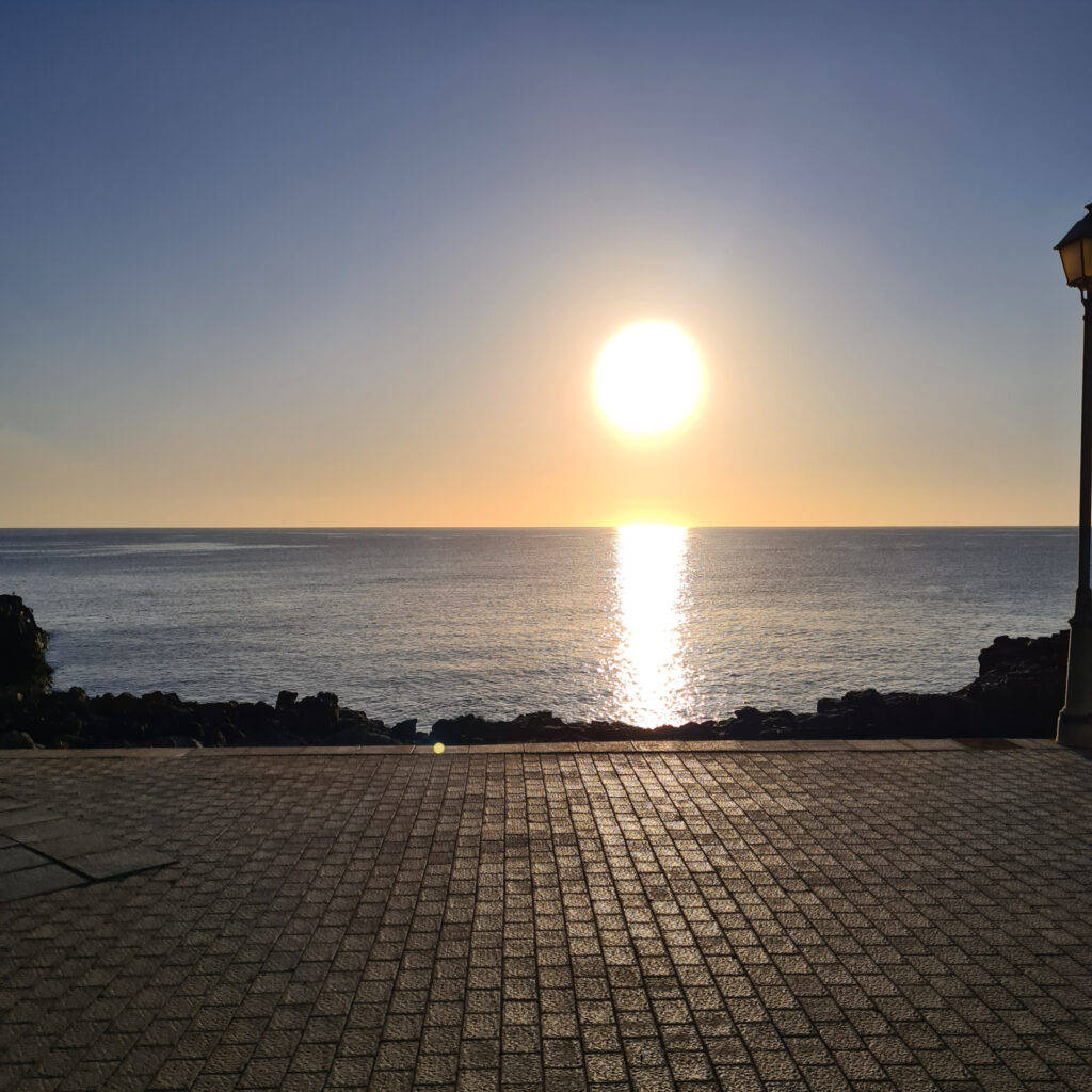 sun over seafront