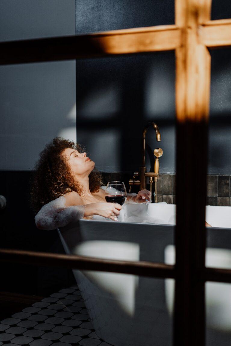 pexels cottonbro photo black woman in bubble bath with wine glass